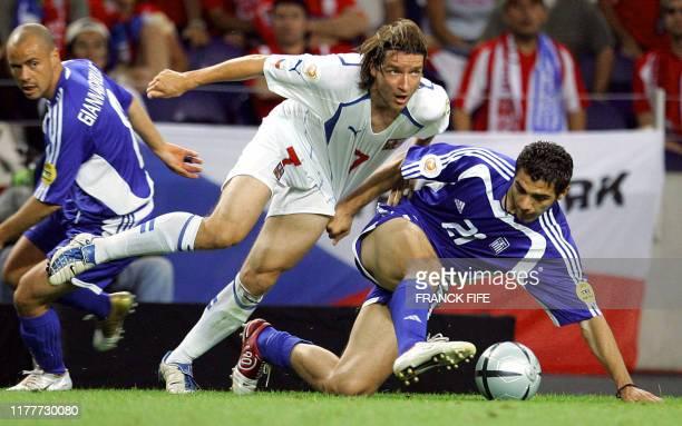 Czech midfielder Vladimir Smicer and Greece's midfielder Konstantinos Katsouranis tussle for the ball 01 July 2004 at Dragao stadium in Porto during...