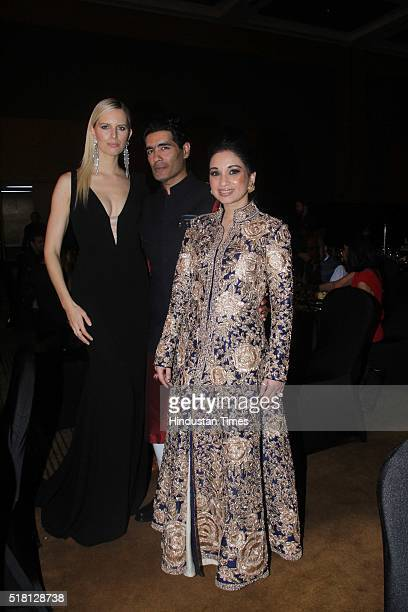Czech model and actress Karolina Kurkova with Indian Fashion Designer Manish Malhotra during the MINT Luxury Conference at Grand Hyatt Santacruz on...