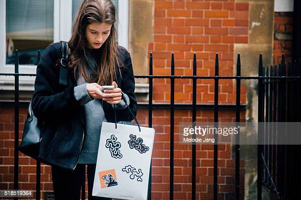 Czech model Bara Podzimkova checkers her phone after the JW Anderson show at Yeomanry House during London Fashion Week Autumn/Winter 2016/17 at on...