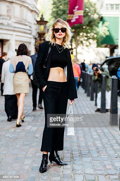Czech model Hana Jirickova exits the Topshop Unique show at The Queen Elizabeth II Centre during London Fashion Week Spring/Summer 2016/17 on...