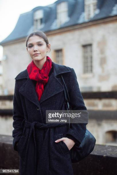 Czech model Jana Tvrdikova wears a red scarf and belted coat after the Valentino show on March 04 2018 in Paris France