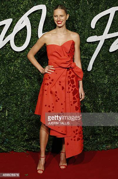 Czech model Karolina Kurkova poses for pictures on the red carpet upon arrival to attend the British Fashion Awards 2014 in London on December 1 2014...