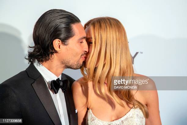 Czech model Petra Nemcova and Benjamin Larretche kiss as they arrive to attend the Elton John AIDS Foundation Academy Awards Viewing Party in West...