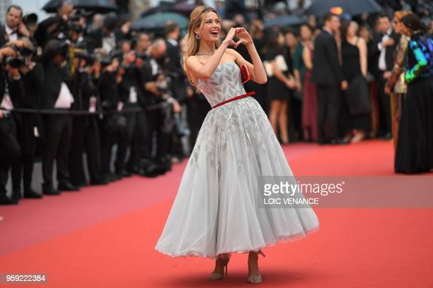 """Czech model Petra Nemcova poses as she arrives on May 16, 2018 for the screening of the film """"Burning"""" at the 71st edition of the Cannes Film..."""