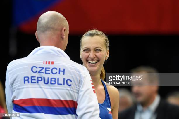 Czech Petra Kvitova celebrates with Czech captain Petr Pala after defeating Swiss Belinda Bencic during the first round of the International Tennis...