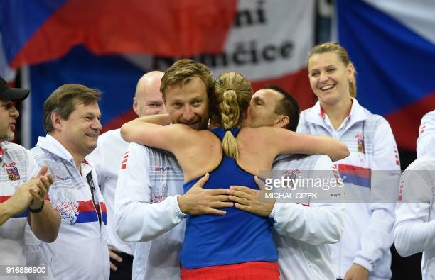 Czech Petra Kvitova celebrates with members of the Czech team after defeating Swiss Belinda Bencic during the first round of the International Tennis...