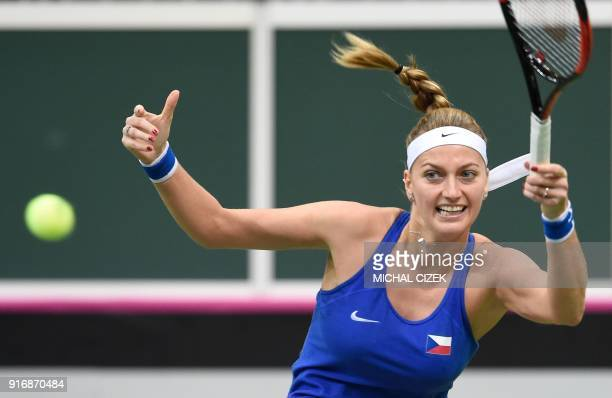 Czech Petra Kvitova returns the ball to Swiss Belinda Bencic during the first round of the International Tennis Federation Fed Cup match between...