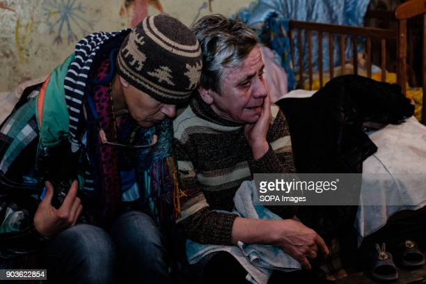 Czech photographer Iva Zimova trying to comfort Babushka as she often cry lost hope for a better life sometimes The conflict between the Russian...