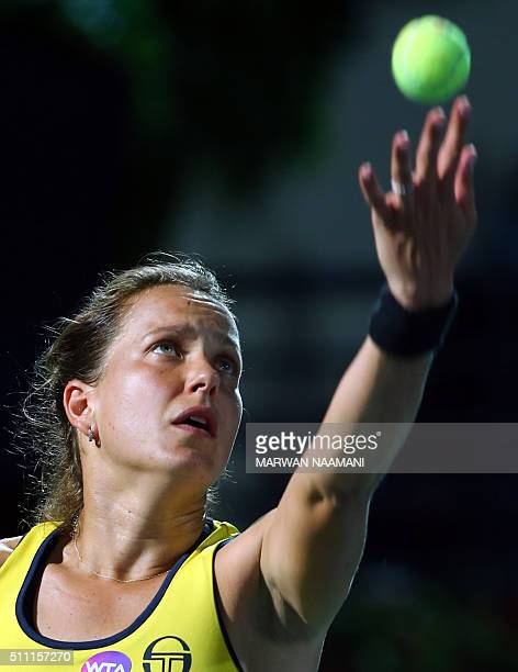 Czech player Barbora Strycova serves the ball to Serbia's Ana Ivanovic during their quarterfinal WTA game as part of the Dubai Duty Free Tennis...