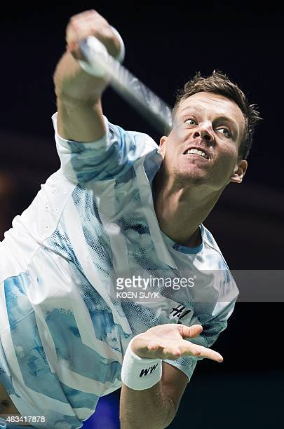 Czech player Tomas Berdych returns the ball to French player Gilles Simon during their semifinal tennis match at the ABN AMRO World Tennis Tournament...