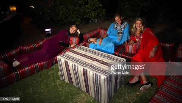 Czech players, Petra Kvitova, Lucie Safarova and Andrea Hlavackova pose with a falcon dressed in tradiional local dress during the players party on...