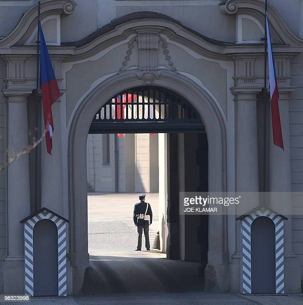 A Czech policeman guards the entrance to Prague's castle where US President Barack Obama and Russian President Dmitry Medvedev signed new START...