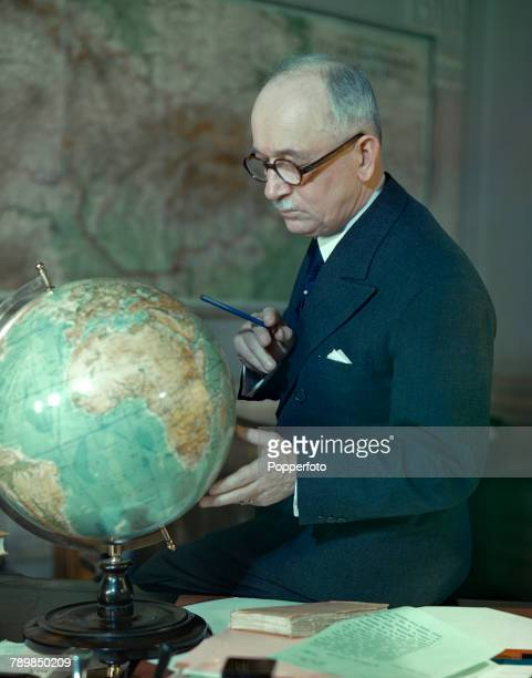 Czech politician and President of Czechoslovakia in exile Edvard Benes studies a globe on his desk in London in February 1943