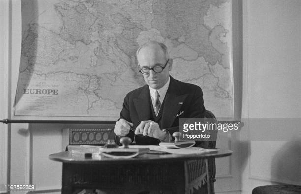 Czech politician Edvard Benes President of Czechoslovakia in exile pictured signing the new constitution during a swearing in ceremony of the new...