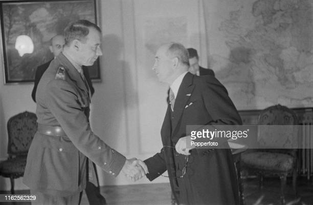 Czech politician Edvard Benes President of Czechoslovakia in exile pictured on right shaking hands with new Secretary of War Rudolph Viest during a...