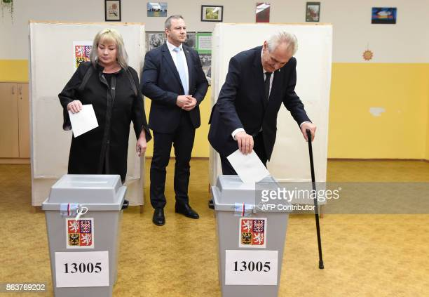 Czech President Milos Zeman and his wife Ivana cast their ballots at a polling station during the first day of voting in the Czech elections on...