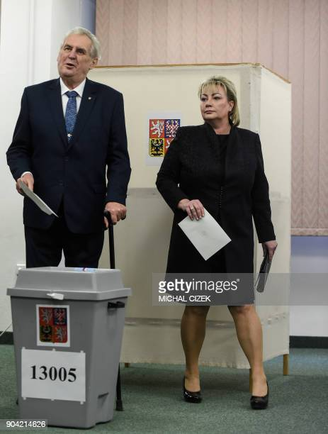 Czech President Milos Zeman and his wife Ivana cast their ballots at a polling station in Prague on January 12 2018 The first round of the...