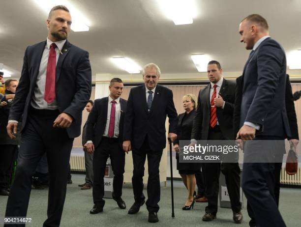 Czech President Milos Zeman and his wife Ivana leave a polling station in Prague on January 12 2018 The first round of the presidential election will...