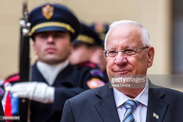 Czech President Milos Zeman and Israeli President Reuven Rivlin inspect the guard of honor during welcoming ceremony at the Prague Castle on October...