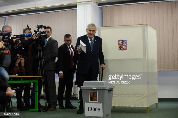 Czech President Milos Zeman arrives to cast his ballot at a polling station in Prague on January 12 2018 The first round of the presidential election...