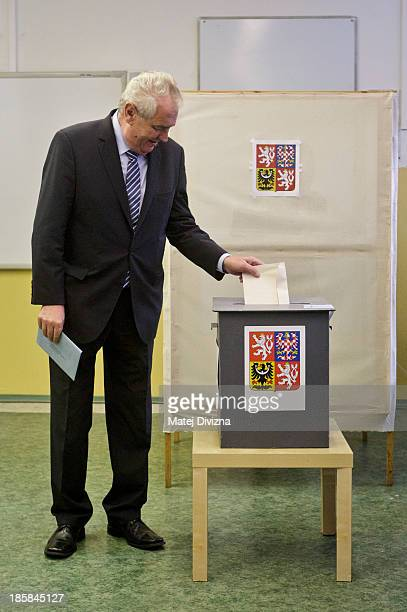Czech President Milos Zeman casts his ballot during the first day of the Czech early election on October 25 2013 in Prague Czech Republic This early...