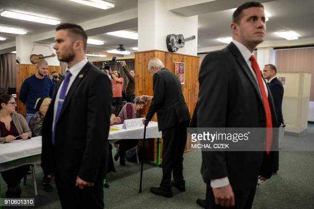 Czech President Milos Zeman gets his ballot papers at a polling station in Prague on January 26 during the second round of presidential elections in...