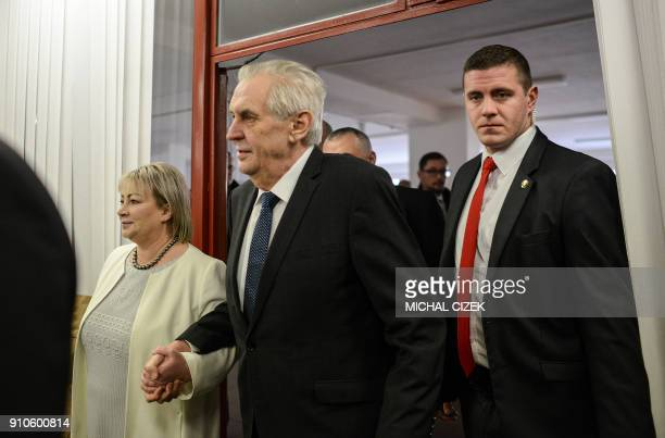Czech President Milos Zeman is accompanied by his wife Ivana as he arrives at a polling station in Prague on January 26 during the second round of...