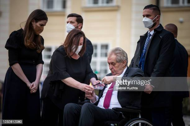 Czech President Milos Zeman lights a candle to commemorate victims of the COVD-19 pandemic at the Prague Castle on May 10, 2021 in Prague, Czech...