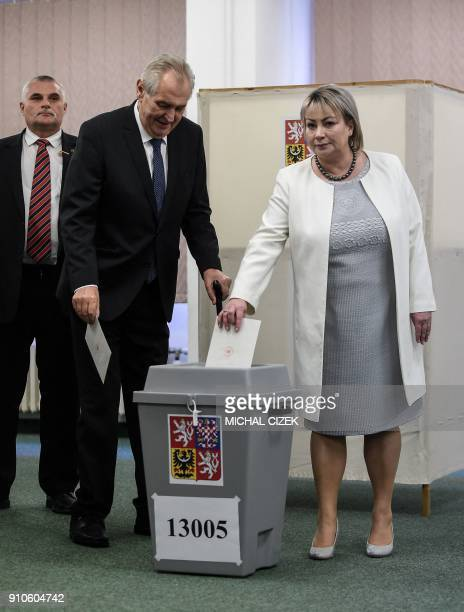 Czech President Milos Zeman looks on as his wife Ivana casts her ballot at a polling station in Prague on January 26 during the second round of...