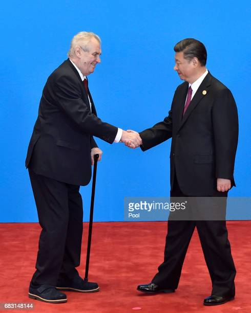 Czech President Milos Zeman shakes hands with Chinese President Xi Jinping during the welcome ceremony for the Belt and Road Forum, at the...