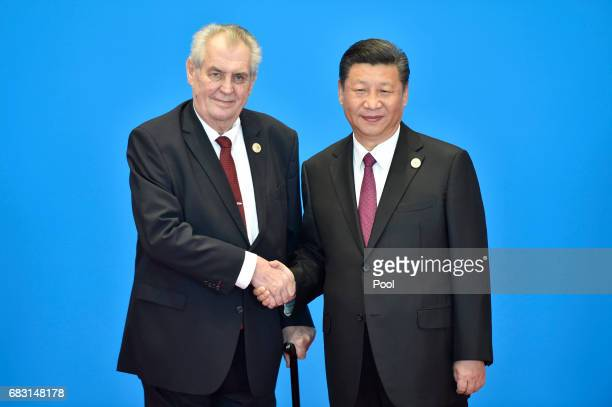 Czech President Milos Zeman shakes hands with Chinese President Xi Jinping during the welcome ceremony for the Belt and Road Forum at the...
