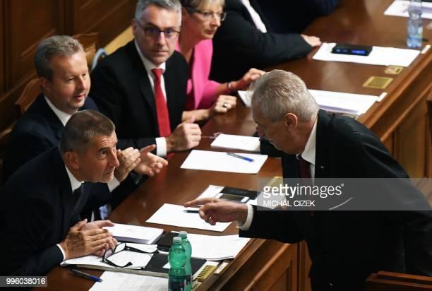 Czech President Milos Zeman talks with Czech Prime Minister Andrej Babis after his speech in the Czech Parliament in Prague Czech Republic on July 11...