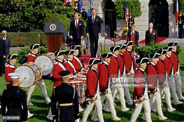 Czech President Vaclav Havel and US President George HW Bush watch a marching band on the White House's South Lawn during the former's State Arrival...