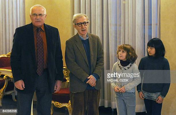 Czech President Vaclav Klaus poses for photographers with the US Movie director and actor Woody Allen and his daughters Manzie and Bachet on 20...