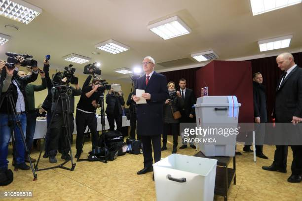 Czech presidential candidate Jiri Drahos casts his ballot at a polling station in Prague's Lysolaje district on January 26 during the second round of...
