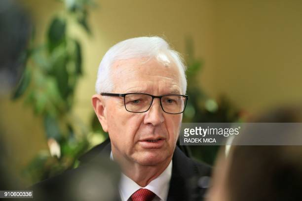 Czech presidential candidate Jiri Drahos speaks with journalists at a polling station in Prague's Lysolaje district on January 26 during the second...