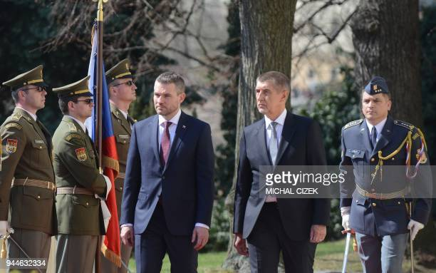 Czech Prime Minister Andrej Babis and his Slovakian counterpart Peter Pellegrini review a guard of honor before their meeting on April 11 2018 in...