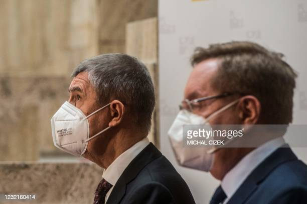 Czech Prime Minister Andrej Babis and newly appointed Czech Health Minister Petr Arenberger talk to the media during the inauguration of Arenberger...