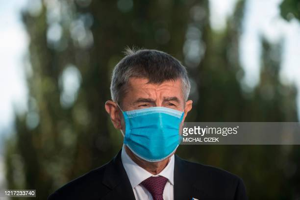 Czech Prime Minister Andrej Babis wears a face mask as he gives a statement with his Slovakian counterpart during a meeting on June 3, 2020 in Prague.