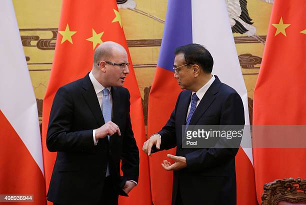 Czech Prime Minister Bohuslav Sobotka chats with China's Premier Li Keqiang during signing ceremony at the Great Hall of the People on November 26,...