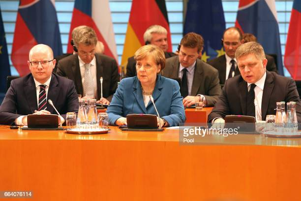 Czech Prime Minister Bohuslav Sobotka, German Chancellor Angela Merkel and Slovak Prime Minister Robert Fico have a joint press briefing as they...