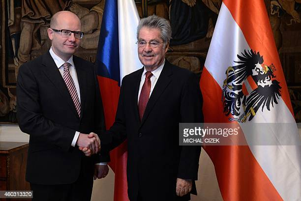 Czech Prime Minister Bohuslav Sobotka shakes hand with Austrian President Heinz Fischer before their meeting on December 11 2014 in Prague AFP...
