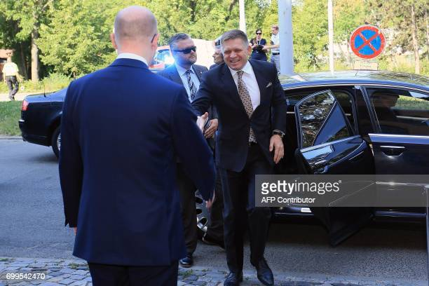 Czech Prime Minister Bohuslav Sobotka welcomes Slovak Prime Minister Robert Fico arriving for a joint meeting with the Austrian Chancellor on June...