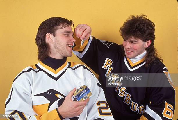 Czech professional hockey player Jaromir Jagr of the Pittsburgh Penguins pretends to feed sardines to his teammate Canadian Luc Robitaille February...