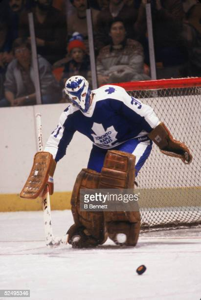 Czech professional hockey player Jiri Crha goalie of the Toronto Maple Leafs eyes the puck as he skates on the ice during a road game January 1981