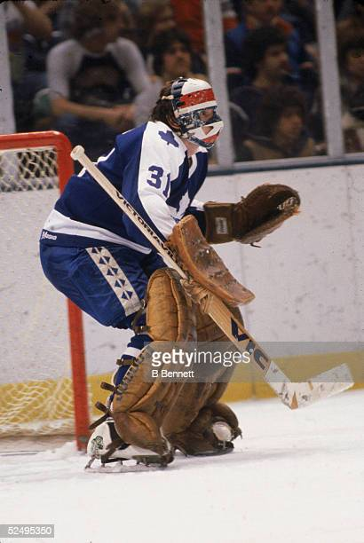 Czech professional hockey player Jiri Crha goalie of the Toronto Maple Leafs defends his goal during a road game February 1980