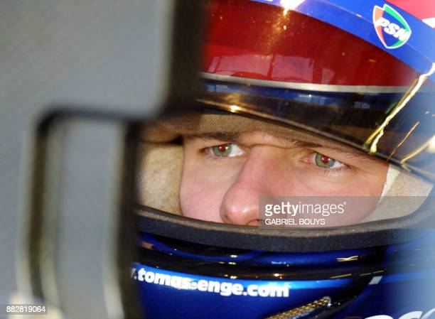 Czech ProstAcer driver Thomas Enge watches TV screen in the pits of the Monza racetrack during the second free practice session 15 September 2001 on...