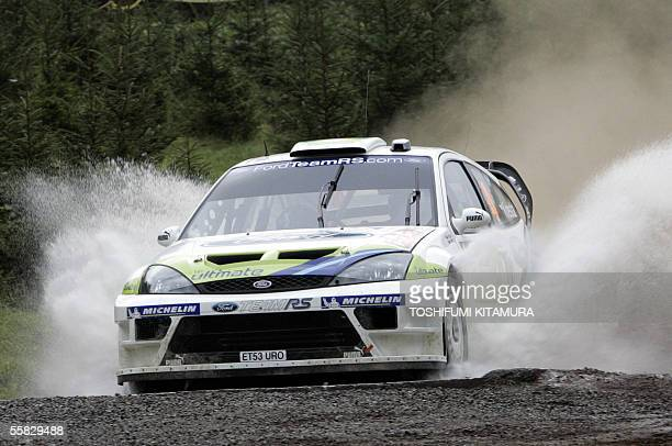 Czech rally drivers Roman Kresta and his co-driver Jan Tomanek of drive their Ford RS WRC 04 through water in the first leg, SS2 of the 13th round of...