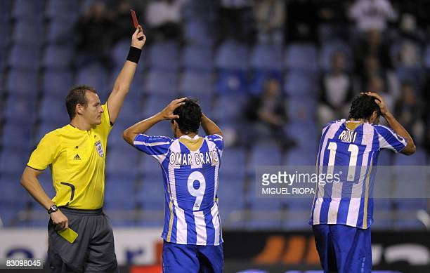Czech referee Pavel Kralovec shows a red card to Deportivo Coruna's player Ivan Sanchez Riki during their UEFA Cup first round second leg football...