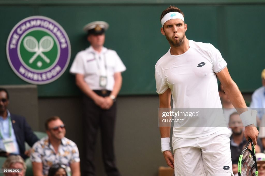 TOPSHOT - Czech Repbulic's Jiri Vesely reacts while playing Spain's Rafael Nadal in their men's singles fourth round match on the seventh day of the 2018 Wimbledon Championships at The All England Lawn Tennis Club in Wimbledon, southwest London, on July 9, 2018. (Photo by Oli SCARFF / AFP) / RESTRICTED